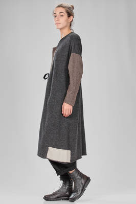 long and wide cardigan in woolen stockinette stitch with blocks of different colors and patched parts - GASA