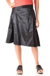 behind draped skirt  -